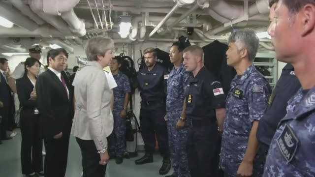 may talks dominated by threat from north korea; japan: tokyo: ext japanese helicopter carrier 'izumo' tied up in port japanese flag flying on board... - shimane prefecture stock videos & royalty-free footage