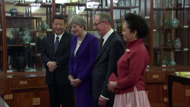 may visit aims to grow postbrexit trade china beijing int various of british prime minister theresa may mp and her husband philip may taking tea with... - liam fox politician stock videos and b-roll footage