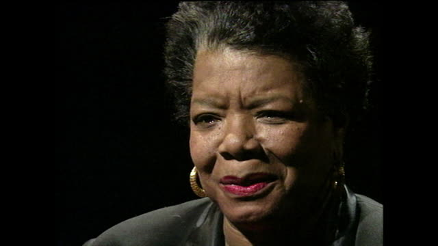 """maya angelou recounts being asked to write her autobiography, """"i know why the caged bird sings"""" by many people and refusing until challenged by her... - black background stock videos & royalty-free footage"""