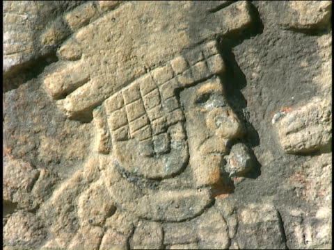 a mayan carving on stone depicts a priest. - mayan stock videos & royalty-free footage