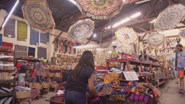 mayan costume and souvenir market at antigua guatemala - latin american civilizations stock videos and b-roll footage