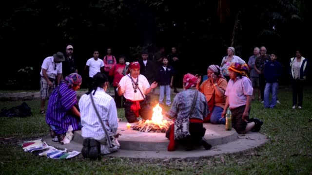 mayan priests made offerings to a sacred fire at an archaological site in quirigua guatemala on wednesday praying the new mayan era that begins on... - mayan stock videos & royalty-free footage