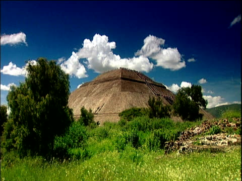 mayan ruins under blue sky and fluffy clouds teotihuacan - mayan stock videos and b-roll footage