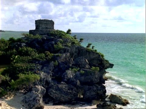 wa mayan temple on cliff top, sea in background, tide coming in, panama. - pre columbian stock videos & royalty-free footage