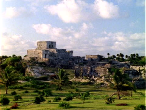 WA Mayan temple ruins, trees and grassy area in foreground, Panama.