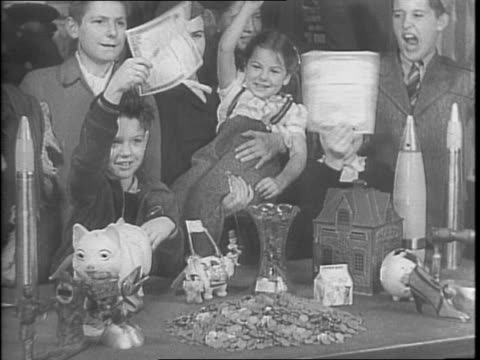 mayor edward joseph kelly holding pig bank children watch / closeups of children watching / kelly weighs the bank with his hands and smiles as he... - scales stock videos & royalty-free footage