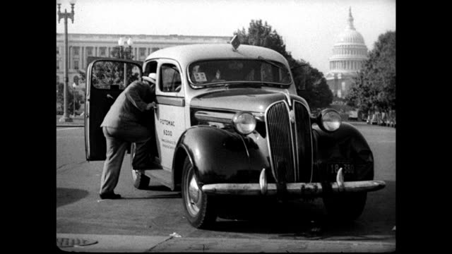 mayor fiorello laguardia getting into taxicab la ms us flag next to side of us capitol building int ms laguardia entering office led by assistant - fiorello la guardia stock videos & royalty-free footage