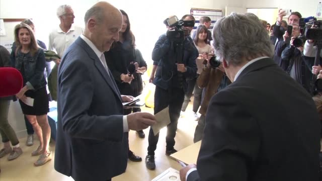 Mayor of Bordeaux and onetime favorite to win the conservative primary Alain Juppe casts his vote in the second round of France's presidential...