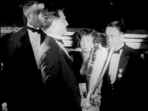 b/w 1925 mayor of charleston, s.c. presenting trophy at dance marathon / chicago / newsreel - 1925 stock videos & royalty-free footage