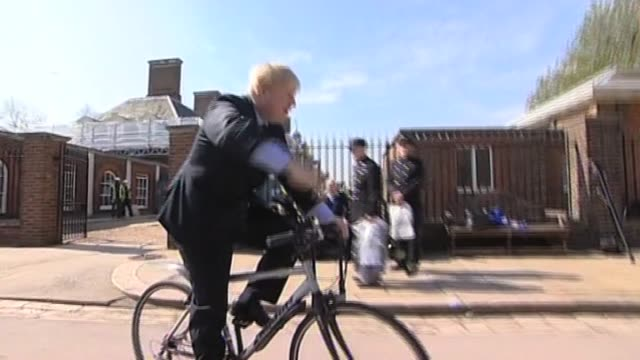 stockvideo's en b-roll-footage met mayor of london boris johnson followed by press as he rides bicycle london 9 april 2010 - number 9