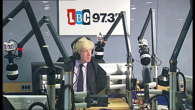 mayor of london presents lbc breakfast show; england: london: lbc: int boris johnson at controls in radio studio, as he removes his headphones and... - television show stock videos & royalty-free footage
