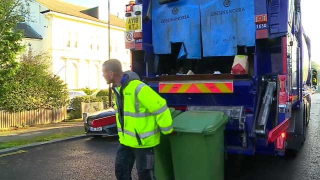 mayor of london targets increase in recycling in the capital; england: london: lewisham: ext 'bobby' chatting with reporter sot bin man watching... - bin stock videos & royalty-free footage