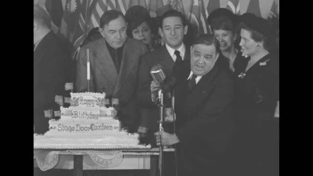 mayor of new york city fiorello h laguardia at stage door canteen adjusts microphone next to birthday cake says he not carey cagney or bellamy âim... - fiorello la guardia stock videos & royalty-free footage