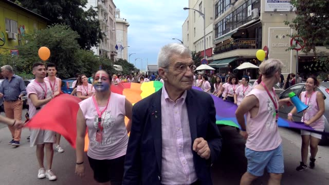 mayor of thessaloniki yiannis boutaris seen marching ahead of the rainbow flag leading the 6th annual pride parade of the city more than 13000... - intersex stock videos and b-roll footage