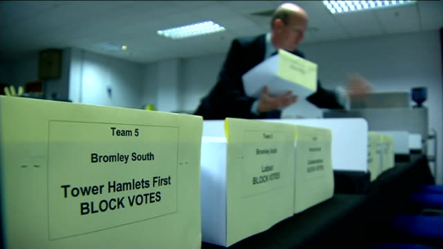 mayor of tower hamlets accused of rigging re-election; t27051402 tower hamlets: int returning officer john williams setting out boxes to be used... - rigging stock videos & royalty-free footage