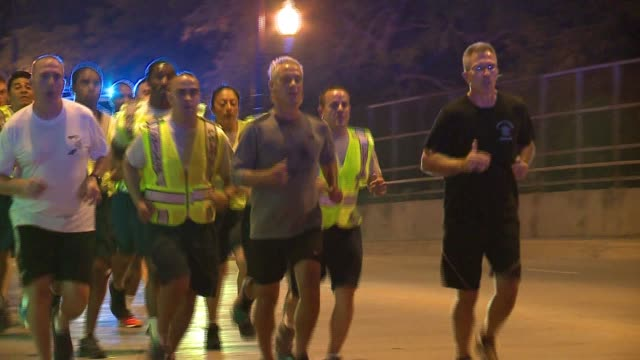 mayor rahm emanuel went out for a three-mile run in the morning with chicago police recruits on september 23, 2016--the day after he delivered a... - military recruit stock-videos und b-roll-filmmaterial