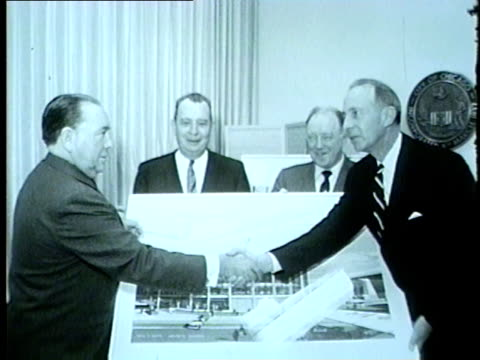 mayor richard j daley poses with a drawing of the new o'hare international airport in 1962 - o'hare airport stock videos & royalty-free footage