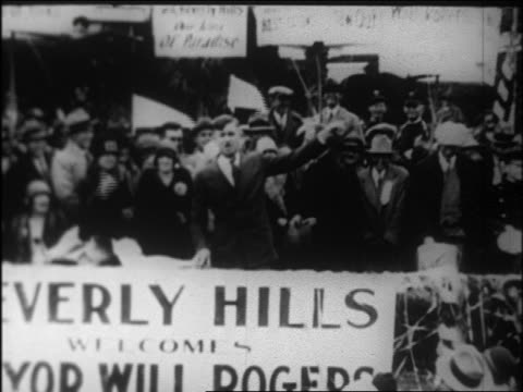mayor will rogers standing behind beverly hills banner talking / newsreel - 1926 stock videos & royalty-free footage