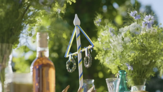 maypole decoration on a midsummer dinner table - solstice stock videos & royalty-free footage