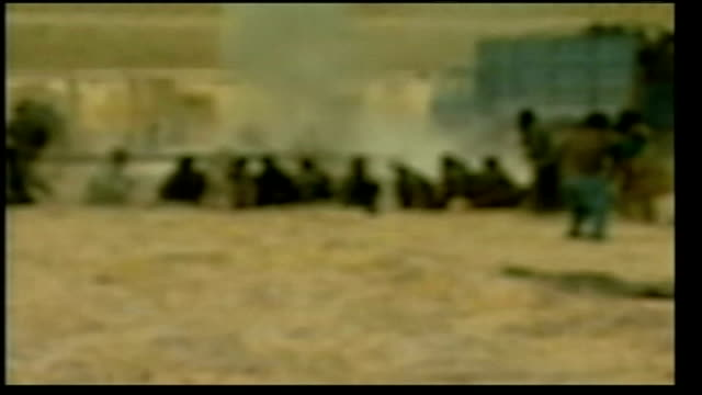 mazar esharif fighting lib ls smoke rising from area where one of prisoners blew himself up with hand grenade zoom in andrea catherwood standing... - hand grenade stock videos & royalty-free footage