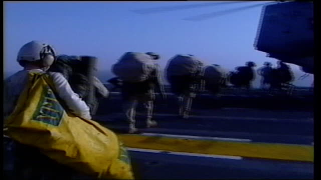mazar esharif fighting pool marines along flight deck with equipment to waiting helicopter bv troops onto helicopter c53 cobra helicopter taking off... - 2001 stock videos & royalty-free footage