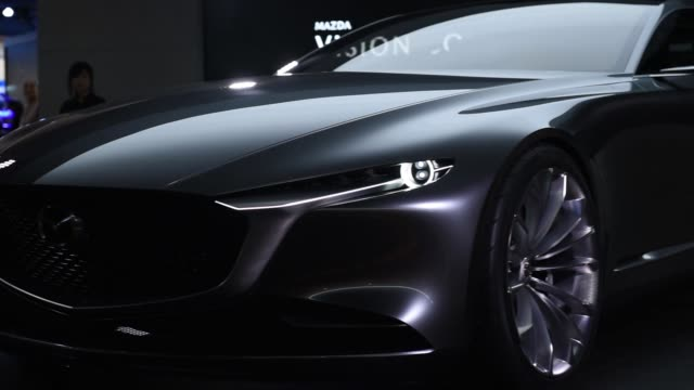 A Mazda Motor Corp Vision Coupe concept vehicle stands on display at the Tokyo Motor Show in Tokyo Japan on Wednesday Oct 25 Close up the fronte...