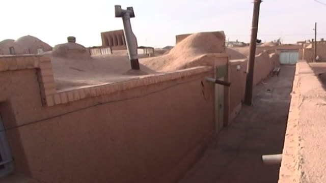 mazraeh-ye kalantar. high-angle view of an alleyway between zoroastrian houses designed in the traditional way in the village of mazraeh-ye kalantar... - yazd province stock videos & royalty-free footage