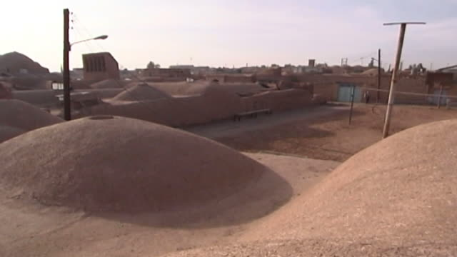 mazraeh-ye kalantar. view of the domed roofs of zoroastrian houses designed in the traditional way in the village of mazraeh-ye kalantar in yazd... - yazd province stock videos & royalty-free footage