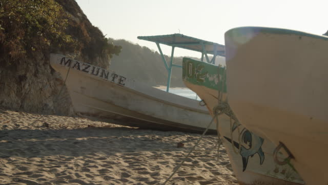 mazunte, oaxaca, beach early morning. boats with mazunte word banner - banner sign stock videos & royalty-free footage