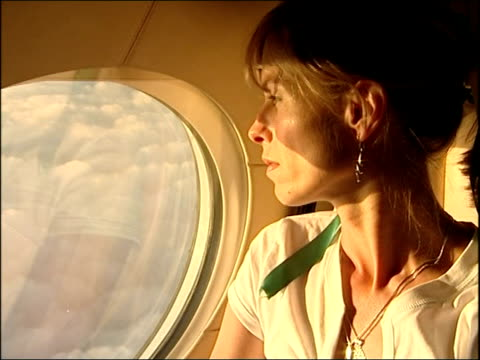 McCann parents depart for Rome to visit pope / McCanns en route to Italy INT Gerry McCann looking out plane window while en route to Italy / Close...