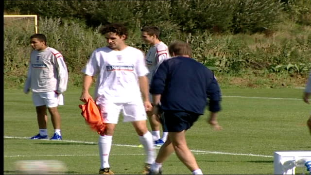 McClaren's new England football squad training Side view of Rio Ferdinand and Ashley Cole training PULL OUT to Owen Hargreaves Phil Neville Rio...
