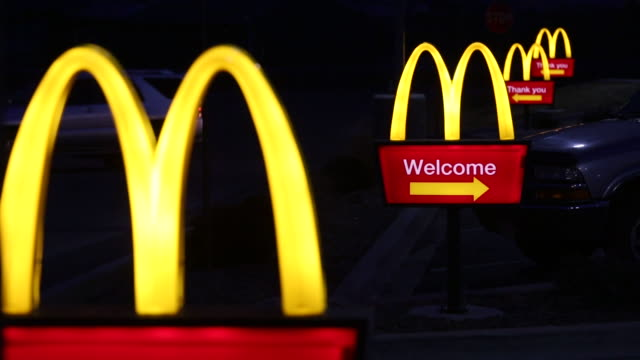 a mcdonalds corp restaurant is illuminated at dawn in shelbyville kentucky us night time shots of mcdonalds signage lit up at night as cars pull into... - mcdonald's stock videos & royalty-free footage