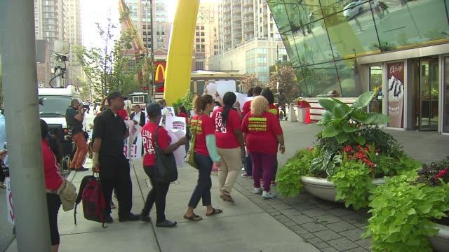 McDonald's employees and activists rallied outside the landmark restaurant at Clark and Ontario in their fight for higher wages and the right to...