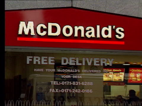 McDonalds lawsuit settled LIB London EXT GVs McDonald's restaurant People sitting eating outside McDonald's