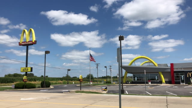 mcdonald's yellow arches and blue sky - parking stock videos & royalty-free footage