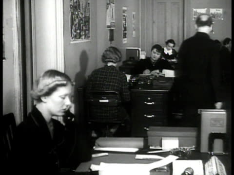 mclean house traffic fg washington dc int ws female secretaries at desks ms theatre producer hallie flanagan talking to two men at desk ms flanagan... - new deal video stock e b–roll