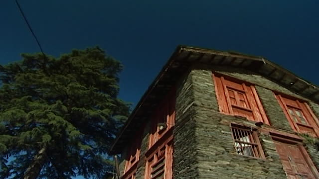 mcleod ganj lowangle shot of a house with a brick facade and woodframed windows - brick house stock videos & royalty-free footage
