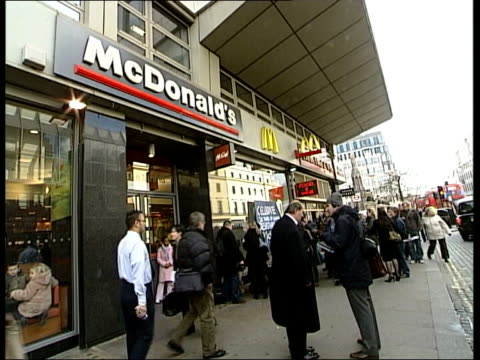 european court of human rights ruling england london helen steel and david morris unfurling poster outside mcdonald's restaurant 'celebrate 20 years... - mcdonald's stock videos and b-roll footage