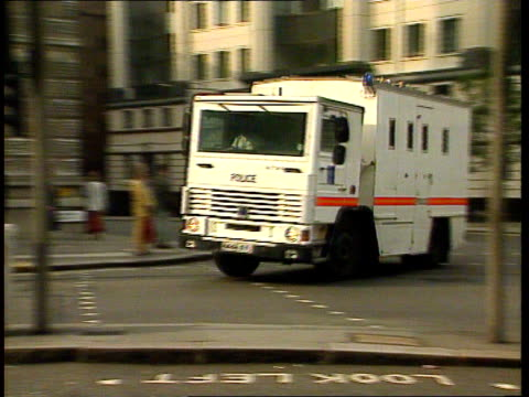 mcnulty sentenced cf england london central criminal court lms police van along pan rl past armed police officer into court complex - criminal stock videos and b-roll footage