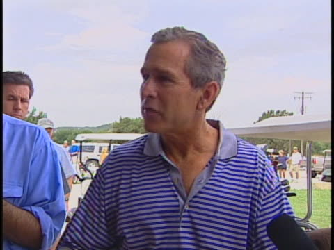 """mcuêpresident george w. bush on vacation in crawford, texas and makes a political blunder in an interview. bush says, """"and ...uh......first things... - blooper film clip stock videos & royalty-free footage"""