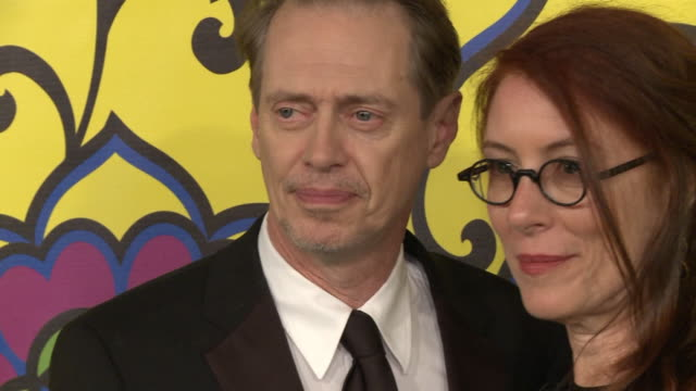 steve buscemi wife jo andres posing for paparazzi and moving along the red carpet at the pacific design center - steve buscemi stock videos and b-roll footage
