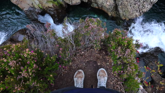 me and my feet in the colorful river with flowers and mud in scotland. - fairy stock videos & royalty-free footage