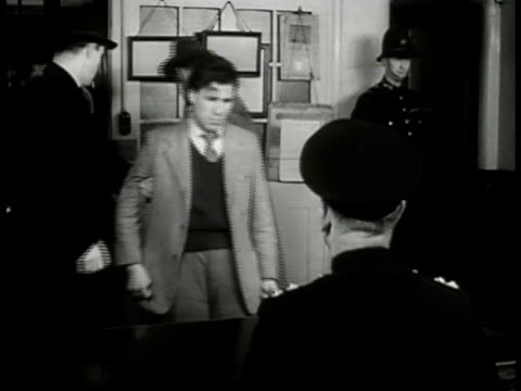 ws 'mead' brought into scotland yard office by 'inspector finch' 'lt roberts' and english detectives being seated before officer at desk cu 'mead' in... - 1949 stock videos & royalty-free footage