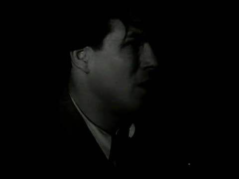 cu 'mead' driving ws car w/ headlights down street ws pulling up to curb london - 1949 stock videos and b-roll footage