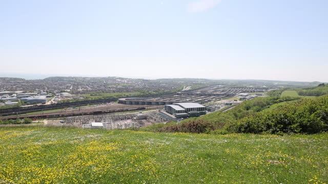 meadow over eurotunnel terminal, landscape of folkestone, kent, u.k., on tuesday, june 1, 2021. - meadow stock videos & royalty-free footage