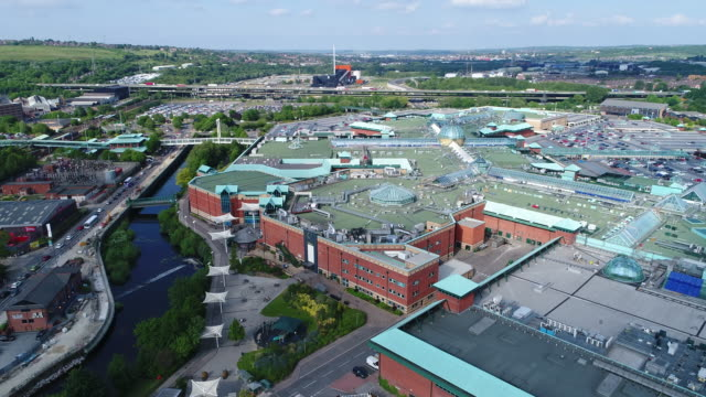 meadowhall rising 4k aerial video with river don - sheffield stock videos and b-roll footage