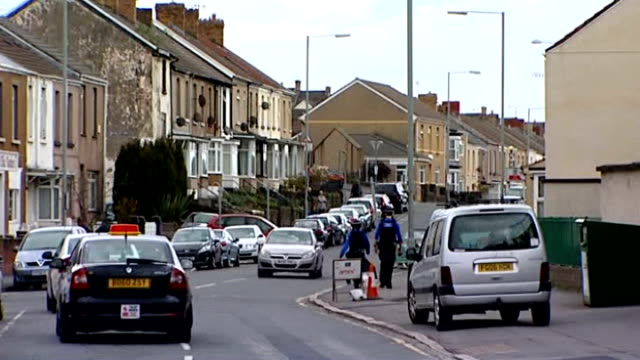 measles epidemic may have claimed first victim wales swansea ext home of gareth williams who may have died after contracting measles street with... - contracting stock videos & royalty-free footage