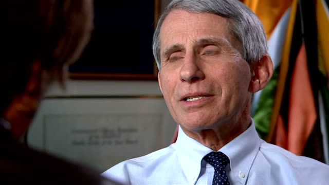 Measles outbreak continues to spread in US USA INT Dr Anthony Fauci set up shot with reporter / interview SOT