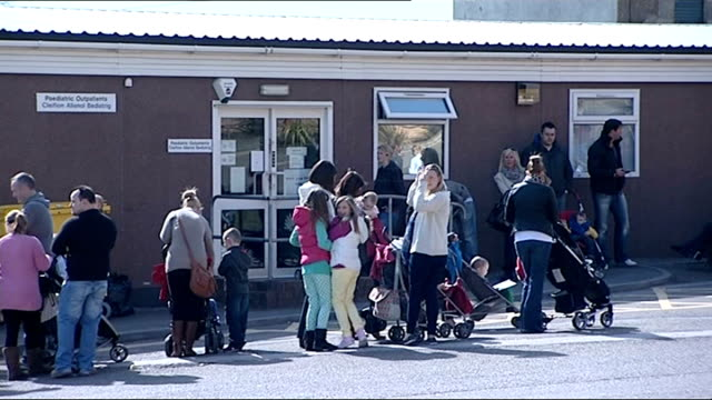 more new cases reported in swansea 6413 wales swansea ext various shots of people queuing up for mmr vaccines sign on door 'mmr jabs this way' more... - mmr stock videos and b-roll footage