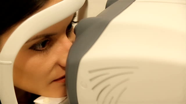measurement of intraocular pressure by an ophthalmologist - ophthalmologist stock videos and b-roll footage